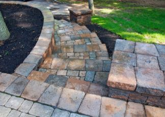 travertine pavers installed in a garden at Joondalup Pavers